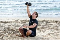 DUMBBELL GET-UP: Build a Surfer Body Workout Routine - No.9 PART C) Now get up as quickly as you can without using your free hand for support.