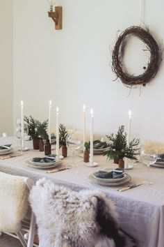 I recently shared my tips for simple Christmas entertaining and table styling for . Scandinavian inspired Christmas table setting with white candle sticks, linen table cloth and sheep skins on the chairs for added warmth Hygge Christmas, Noel Christmas, Merry Little Christmas, Scandinavian Christmas, Simple Christmas, Beautiful Christmas, Winter Christmas, Christmas Wallpaper, Rustic Christmas