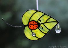 Ladybug-Leaf Stained Glass Suncatcher by connysstainedglass Stained Glass Ornaments, Stained Glass Flowers, Stained Glass Suncatchers, Stained Glass Designs, Stained Glass Projects, Stained Glass Patterns, Stained Glass Art, Stained Glass Windows, Mosaic Glass