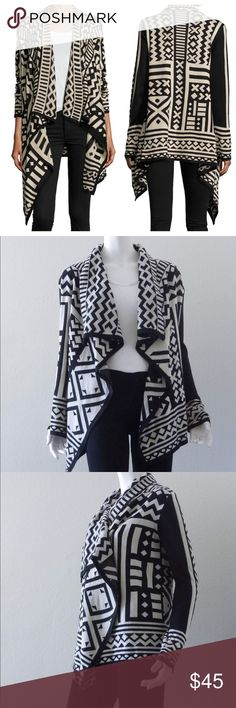 """Anthro Staring at Stars Asymmetric Drape Cardigan In excellent used condition with no signs of wear. Geometric print, shawl collar with an open front. Long sleeves, draped silhouette. Asymmetric hem. 100% acrylic. Dry clean or hand wash. Approximate measurements laid flat: sleeves 25""""; pit to pit 18"""" across; shortest length 24.5"""" back; longest length 33.5"""" front. Please message me with any questions prior to purchasing. Thank you. Anthropologie Sweaters Cardigans"""