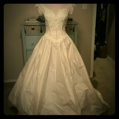 Gorgeous Raw silk boutique wedding gown Raw silk, beaded and pearl bodice.  Never worn. Excellent condition. Dresses Wedding