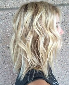 Beach waves on short blonde hair.