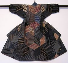 """Cotton, silk boy's patchwork kimono consisting of more than 135 separate pieces of precisely cut and hand-stitched cloth fragments worked into a trompe l'oeil pattern. The design bears some resemblance to the so-called """"himitsu bako"""" (secret boxes) of the Hakone region, which were decorated with intricate geometric marquetry using different varieties of wood."""