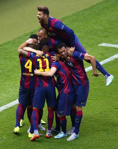 Gerard Pique of Barcelona (top) celebrates with team mates after the goal scored by Ivan Rakitic during the UEFA Champions League Final between Juventus and FC Barcelona at Olympiastadion on June 6, 2015 in Berlin, Germany.