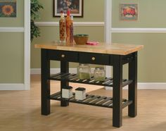 Whitewood Furniture.  Classic black goes well in many kitchens.  But you can have yours in any color stain or paint you desire.  www.woodcraftedfurniture.com