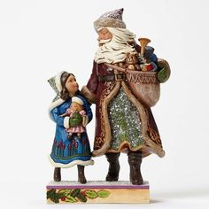 Jim Shores Victorian collection sparkles with the warmth of rich colors topped with a subtle sugary finish. This enchanting Santa with Child captures the wonder of Christmas in a heartfelt scene of ho