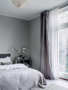 gray, floor to ceiling drapes/windows.