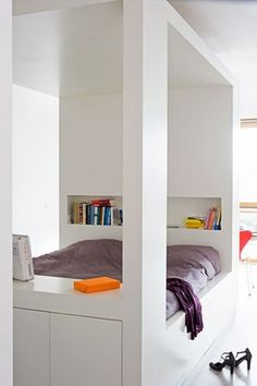 Great way to achieve a separate room feeling for a bed in a loft-like or single room space. Also includes storage in under bed drawers, storage cupboards at the end of the unit and built-in storage niches. Built In Bed, Built Ins, Estilo Interior, Shelves In Bedroom, Book Shelves, Deco Design, Home Bedroom, Modern Bedroom, Beautiful Bedrooms