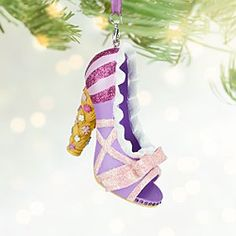 Rapunzel's sparkling slipper ornament will transform your holiday tree into a tower of delight, with more than a tangle of glittering trims, faceted gems and fairytale magic fit for a Disney Princess.