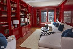 Super lacquered, candy apple red, library/family room on the Upper East Side that's so freaking glossy you can literally see the reflection of the window on the wall!!