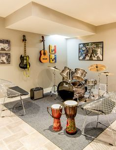 Love this bright contemporary basement music studio! They could fit an entire band in there.