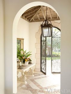 Entryway with Wrought Iron Doors and rustic pitched ceiling - Villa Perfecta by Jane Schwab and Cindy Smith of Circa Interiors via Veranda interior design 2012 design designs interior design ideas Feng Shui, Beautiful Interiors, Beautiful Homes, Veranda Magazine, Beachfront Property, Wrought Iron Doors, Interior Decorating, Interior Design, Interior Ideas