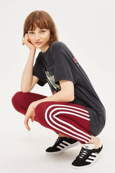 Update your sports wardrobe or gym options with these retro-style burgundy leggings by adidas Originals.