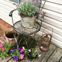 This grouping makes me smile with the beautiful petunias, lavender and junk treasures.