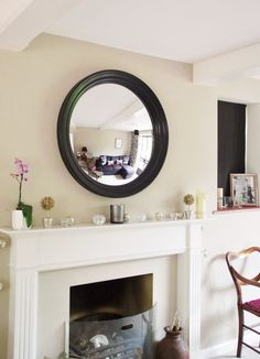 A well positioned mirror can do wonders for the home - adding light, space and interest. Here are 4 essential tips for hanging a round mirror above fireplace ideas 4 Essential Tips for Hanging a Round Mirror above a Fireplace - Omelo Mirrors Above Fireplace Ideas, Mirror Above Fireplace, Fireplace Mantle, Stone Mantle, Black Round Mirror, Round Mirrors, Hanging Mirrors, Circle Mirrors, Modern Mirrors