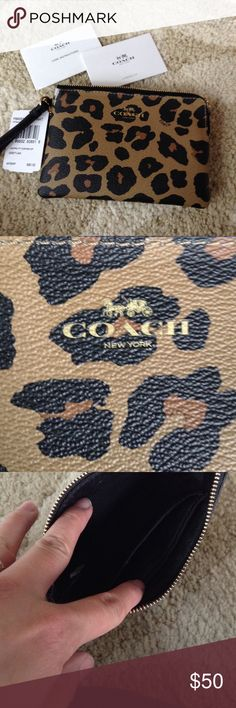 Coach wristlet Cheetah print NWT wristlet!  Perfect for carrying credit cards and phone when out! Coach Bags Clutches & Wristlets