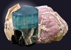 Indicolite Tourmaline with lavender Lepidiolite and Quartz to the side. 'Obsidian protected'. Paprok Mine Afghanistan.