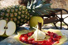 Carpaccio de pinya natural amb sorbet de poma verda i coulis de gerds
