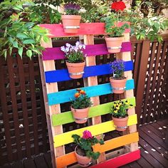 Create a bright & colorful DIY upcycled rainbow pallet planter project with these simple instructions. A great family weekend project that kids will love.