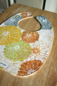My new fav!!!  zoe needs this! Blomma : Plastic Lined Bib., shabby chic, flower fabric, blend fabrics