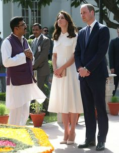 Moment of reflection:  the royal couple are shown a giant bronze statue inside the complex of Gandhi