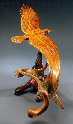 """""""In Turn' wood carving of an eagle by J Christopher White - photo by Mel Schockner;  made of West Texas Juniper on Mesquite;  52""""wingspan"""