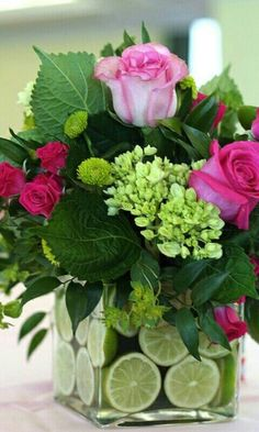 Adorable arrangement with roses, hydrangea, spray roses, kermit button poms, and limes.