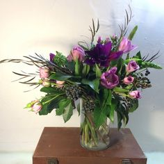 Purple and pink flower arrangement with fresh berries, by Gardenia Organic