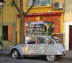 'Countryside in France.' said previous pinner • Citroen 2CV outside a charcoal chicken shop • French cuisine