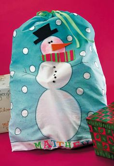 """crafts-n-things-snowman-pillowcase-stocking.  I wouldn't use it as a stocking but rather an """"oversized"""" gift bag."""
