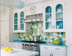 Love the colorful backsplash and color in the cabinets--but I won't have glass doors in the kitchen.