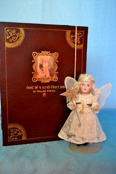 "Antique S.F.B.J., bisque head doll with ""One of a Kind"" Petite Trousseau wardrobe with 5 outfits and accessories by Pauline Porter"