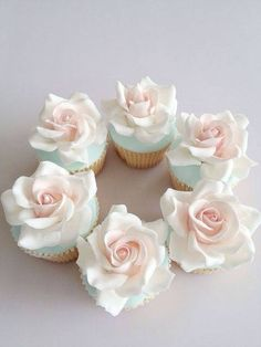 beautiful rose cupcakes - could do a version to include flowers in the bride's bouquet