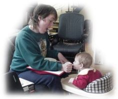 Mother with CP feeds baby - link goes to Parent Empowerment Network for parents with disabilities