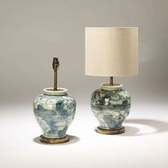 Pair of small abstract blue&white ceramic lamps on distressed brass bases