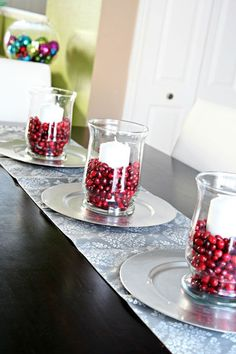 Hurricane vases can be filled with fresh cranberries and candles for the holidays.