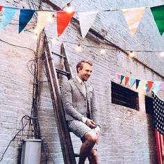 Patrick Janelle thanks guests at his backyard BBQ in a Thom Browne mens suit.