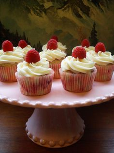 Close Up Photo of Cupcakes with White Frosting, Topped with Rasberries