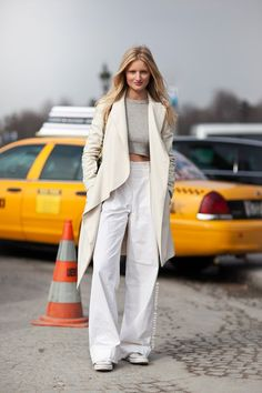 Candice Lake // long blonde hair, cropped grey top, cream coat, high-waisted white wide leg jeans & Converse sneakers #style #fashion #streetstyle