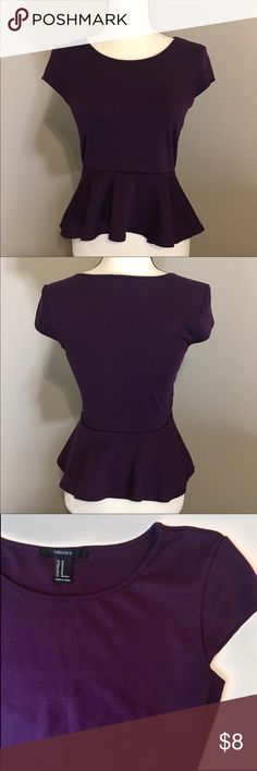 F21 Peplum Top Price is Firm - Please do not offer Excellent condition • no flaws -  Color is deep jewel toned violet :  with cap sleeve.  Tag says medium /but fits like a small\  Has some stretch for comfort Thanks for checking out my closet Forever 21 Tops