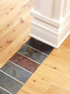 Use a row of natural tiles to create a unique transition between two rooms' hardwood floors.
