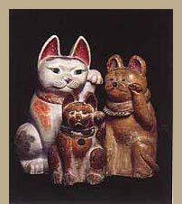 Maneki Neko - Grouping of Meiji, Taisho and Showa period clay figures, 33 cm., 41.5 cm. and 49 cm.