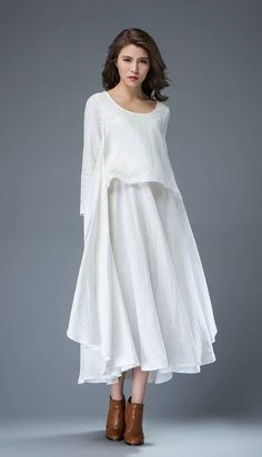 Youll create an entrance wherever you go with this beautifully flowing white linen dress. Flaunting gorgeous layers, the dress is perfect for cool summer days and has a romantic feel. The dress has long sleeves, a fit and flare style and a round scoop neck. Super feminine and sophisticated,