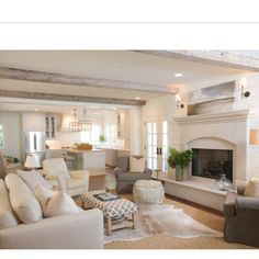 Love the second animal skin rug layered on top of regular neutral rug