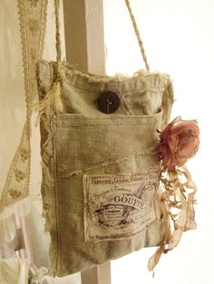Lilla's famous French pouches.  Add flowers, hang from tree branches, backs of chairs, chairs down the aisle.