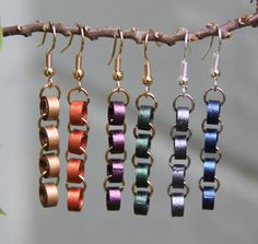 Learn how to use strips of paper to make beads for a trendy chain earring!