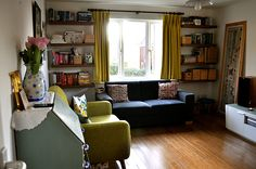the home of huma qureshi. sweet + eclectic little living room.