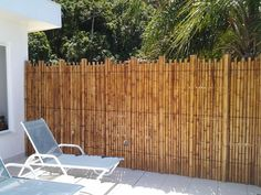Photograph of Bamboo Fence by Pamela Zottis # Bamboo is versatile durable inexpensive sustainable and leaves environments with a more airy feel. Bamboo House, Bamboo Garden, Bamboo Fence, Patio Roof, Backyard Patio, Backyard Landscaping, Small Patio Design, Garden Design, Outdoor Patio Umbrellas