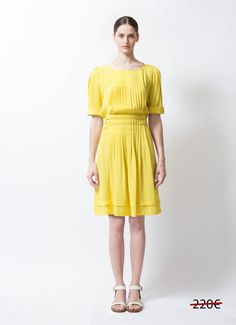- Balenciaga Silk Dress - By Nicolas Ghesquière - Yellow lightweight silk fabric - Pin-tucked front pleated panel - Pleated, flared skirt - Attached waist tie - Pleat detailing at shoulder - Short sleeves with turned up cuff - Front breast snap button closure - Slips-on with no other closure - This item ships out between 1-2 days - 100% Silk