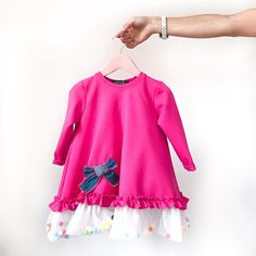 We are a team of 3 inspired moms who make comfortable and stylish clothes for kids and adults. Our warm dresses with long sleeves are made of 80% cotton, 20% elastane and, as all of our clothing, are exclusively decorated with more than 100 colorful textile pom poms. All of the pom